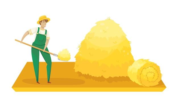 Un contadino in tuta e cappello di paglia che raccoglie il fieno con un forcone. raccolto.