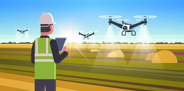 Agricoltore utilizzando drone spruzzatore quad elicottero in volo per spruzzare fertilizzante sul campo smart agricoltura moderna tecnologia organizzazione del concetto di raccolta orizzontale sfondo piatto