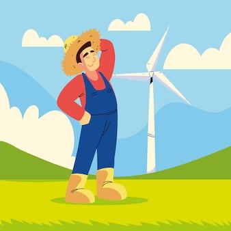 Agricoltore e turbina eolica
