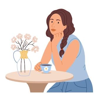 Ragazza di modo nel caffè della via con i fiori sentirsi felice e gioioso