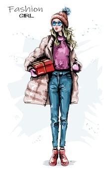 Look invernale di moda ragazza.