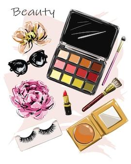 Set moda con ombretti fotografici, rossetto, occhiali da sole, pennello in polvere