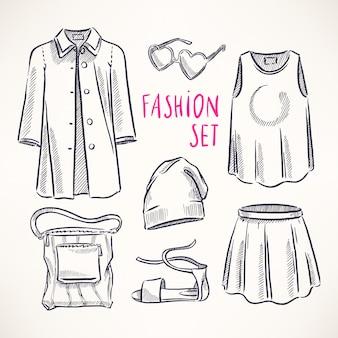 Set di moda con abbigliamento e accessori femminili. illustrazione disegnata a mano