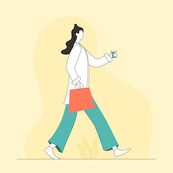 Moda donna che cammina con le borse della spesa
