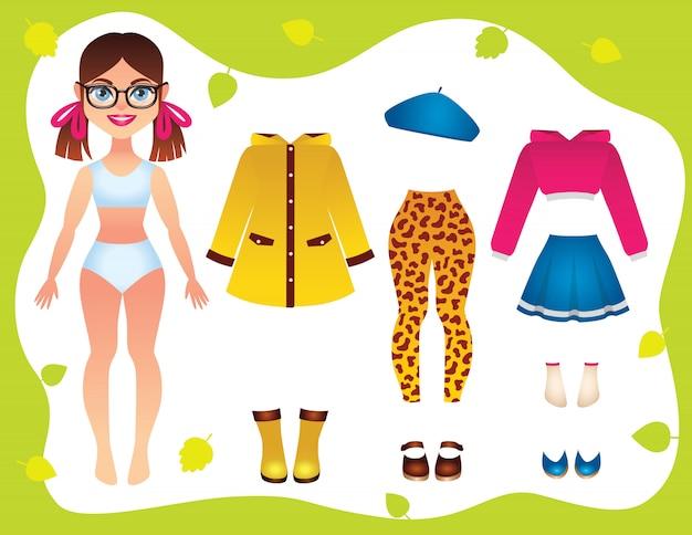Vestiti per ragazze alla moda, cappello, scarpe con una bella bambola di carta