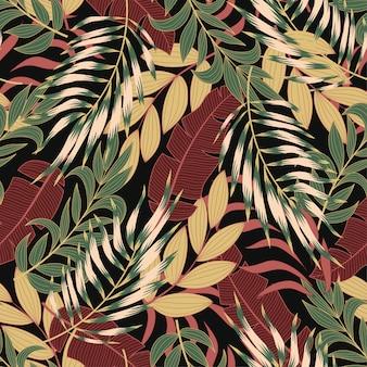 Modello tropicale senza cuciture alla moda con foglie e piante verde brillante e gialle
