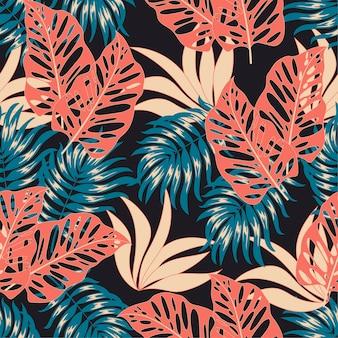 Modello tropicale senza cuciture alla moda con piante e foglie luminose