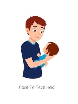 Padre che tiene in braccio il bambino con una posa chiamata presa faccia a faccia