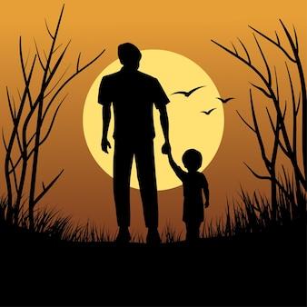 Padre e figlio in silhouette che camminano al tramonto