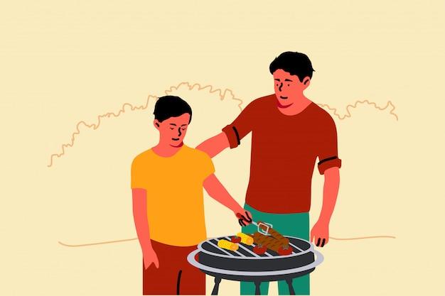Paternità, infanzia, vacanze, famiglia, educazione, concetto di barbecue