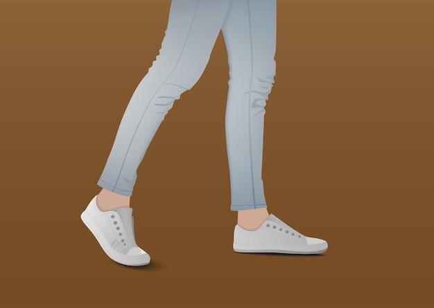 Piedi che camminano su sfondo marrone