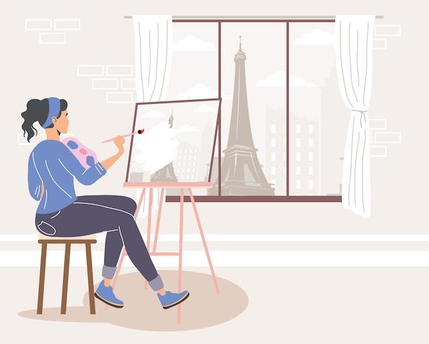 Artista femminile che dipinge seduto