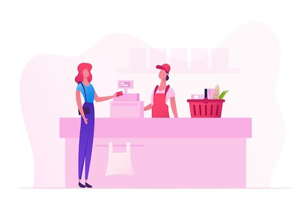 Carattere femminile del cliente con le merci nel carrello della spesa stand nel supermercato