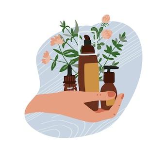 Mano femminile che tiene diversi tubi cosmetici biologici e bottiglie con piante e rami. illustrazione disegnata a mano piatta.