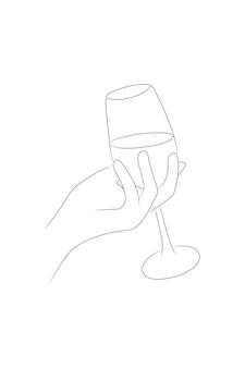 Mano femminile che tiene il bicchiere di vino