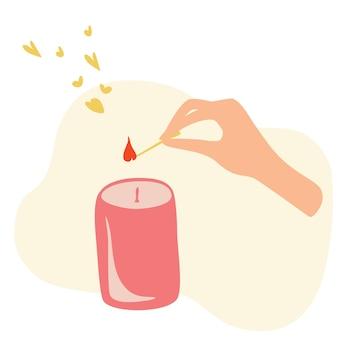 La mano femminile accende la candela con il fiammifero spa relax aroma benessere cura del corpo e meditazione yoga