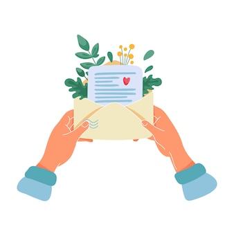 Mani femminili che tengono busta con lettera di carta e bouquet di foglie e fiori gialli all'interno. illustrazione piatta dei cartoni animati