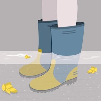 Piedini femminili in stivali di gomma alla caviglia in profondità nell'acqua
