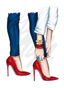Piedini femminili in jeans alla moda e scarpe tacco alto