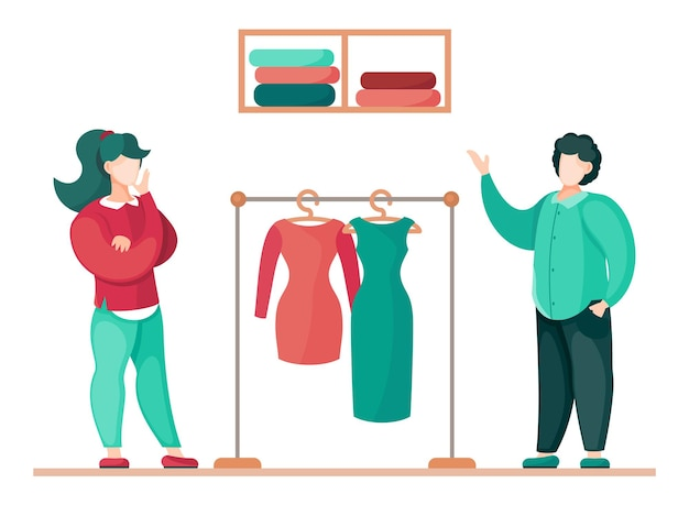 Femmina e maschio in piedi e discutendo di abiti su misura