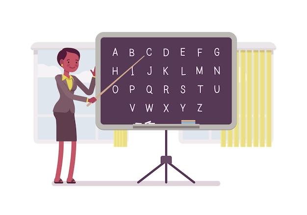 Insegnante di sesso femminile sta insegnando l'alfabeto