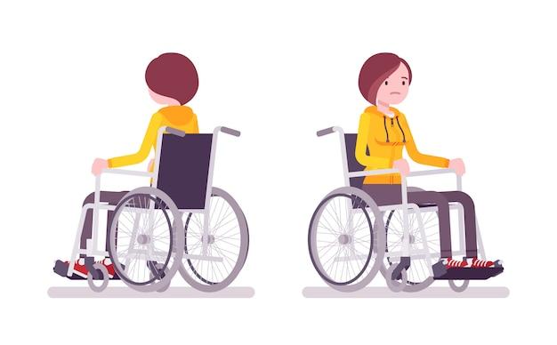 Femmina giovane su sedia a rotelle