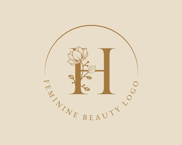 Modello femminile di logo della corona di alloro iniziale della lettera h botanica femminile per il matrimonio del salone di bellezza della stazione termale