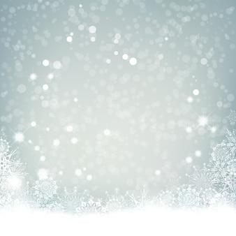 Priorità bassa astratta festiva della neve con luci sfocati