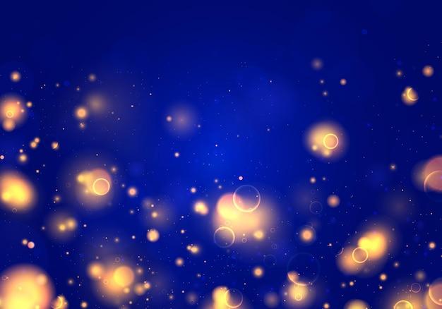 Sfondo luminoso blu e dorato festivo con bokeh di luci colorate.