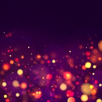 Sfondo luminoso blu, viola e dorato festivo con bokeh di luci colorate.