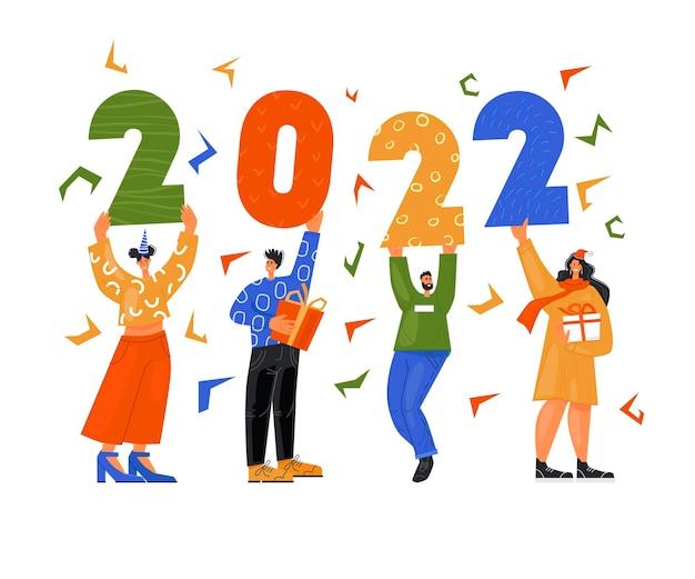 Le persone allegre festose tengono in mano i numeri 2022
