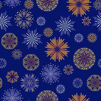 Fuochi d'artificio festivi sul modello senza cuciture blu scuro