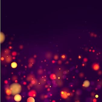 Priorità bassa luminosa viola e dorata festiva con il bokeh variopinto degli indicatori luminosi. cartolina d'auguri di concetto. manifesto di vacanza magica, banner. scintille dorate luminose di notte estratto chiaro