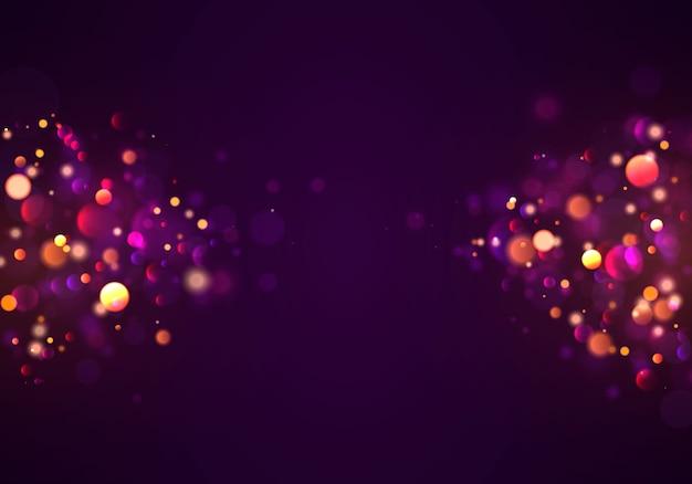 Priorità bassa luminosa viola e dorata festiva con il bokeh variopinto degli indicatori luminosi.