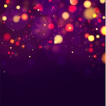Sfondo luminoso viola e dorato festivo con bokeh di luci colorate.