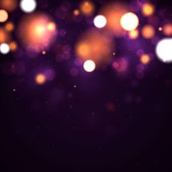 Sfondo luminoso viola e dorato festivo con bokeh di luci colorate dorate.