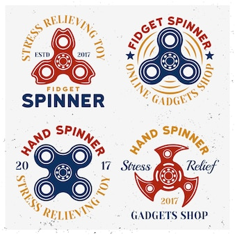 Fidget spinners emblemi colorati, etichette, distintivi o loghi isolati su priorità bassa bianca