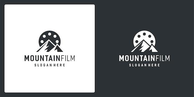 Ispirazione del logo della striscia di pellicola e logo della montagna. vettore premium