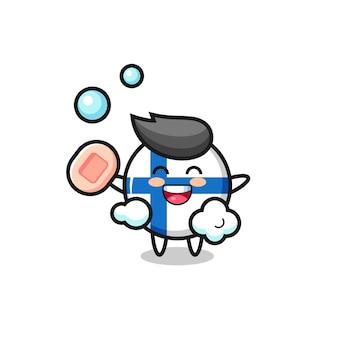 Il personaggio del distintivo della bandiera della finlandia fa il bagno mentre tiene il sapone, un design in stile carino per maglietta, adesivo, elemento logo