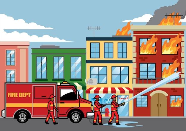 Il vigile del fuoco spegne il fuoco sull'edificio