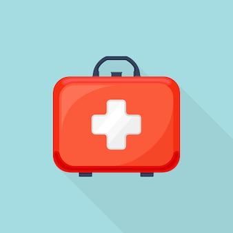 Cassetta del kit di pronto soccorso sullo sfondo. valigia medica