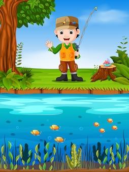 Pescatore che pesca in un fiume