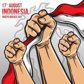 Pugno mano che prende l'illustrazione della bandiera dell'indonesia