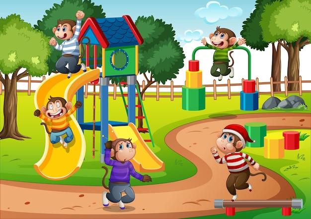 Cinque scimmiette che saltano nella scena del parco giochi