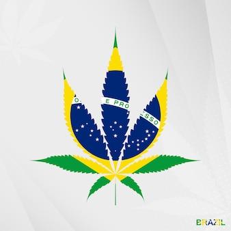 Bandiera del brasile a forma di foglia di marijuana. il concetto di legalizzazione della cannabis in brasile.