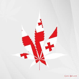 Bandiera della georgia a forma di foglia di marijuana. il concetto di legalizzazione della cannabis in georgia.
