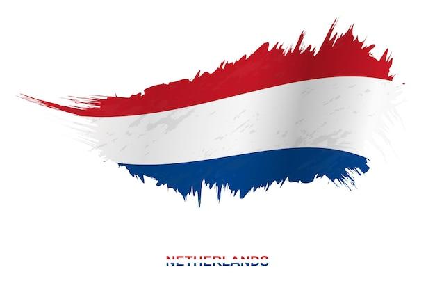 Bandiera dei paesi bassi in stile grunge con effetto ondeggiante, bandiera del tratto di pennello del grunge di vettore.