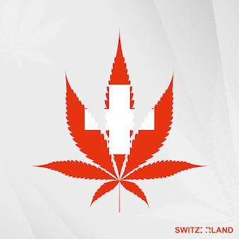 Bandiera della svizzera a forma di foglia di marijuana. il concetto di legalizzazione cannabis in svizzera.