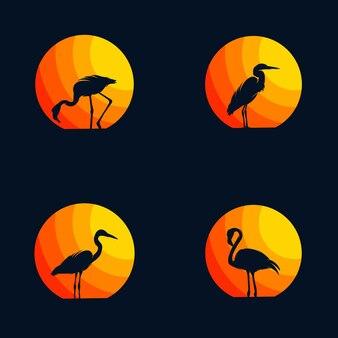 Fenicottero e airone nel vettore di logo di tramonto