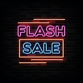 Insegne al neon di vendita flash sulla parete nera